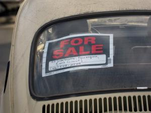 Plymouth car dealer faces angry protest