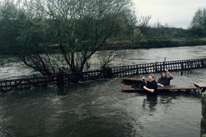 Pub managers enjoy pint in flooded beer garden